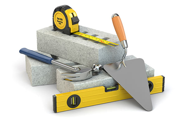 stack of concrete blocks and tools