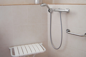 tiled shower with seat and handheld showerhead