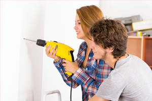 young couple doing home improvements